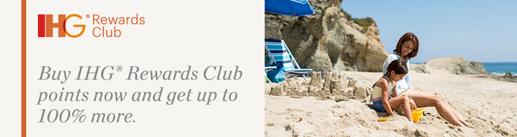 A mother and daughter build sandcastles on a picturesque beach. Buy IHG® Rewards Club points now and get up to 100% more.